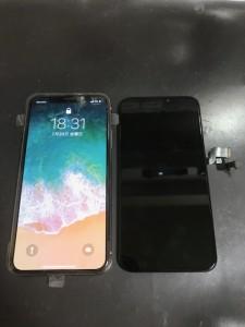 ゴーストタッチしたiPhoneXのパネル